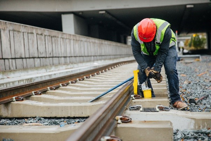 A construction worker working on a train track